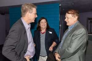 Rick Steves and RCAD president, Dr. Larry Thompson, photobombed by RCLA's executive director, Stephanie Grosskreutz
